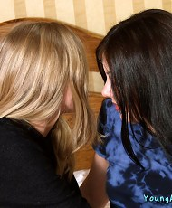 5 pictures of Blonde girl seduces and begin to kiss brunette girlfriend on a bed